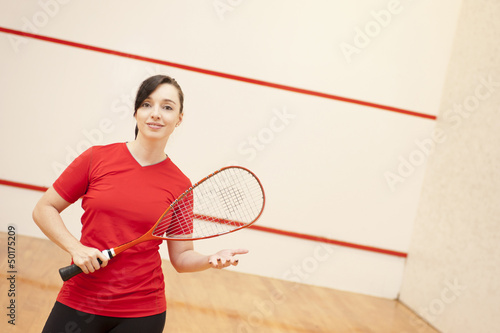 Hispanic woman playing racquetball