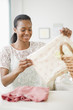 Black woman folding laundry