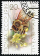 stamp printed in the USSR shows a worker bee collecting pollen