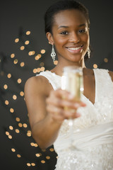 Black woman drinking Champagne