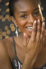 Smiling, glamorous Black woman