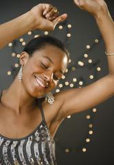Glamorous Black woman dancing