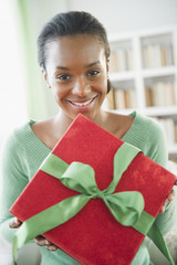 Black woman holding Christmas gift