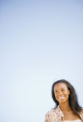 Smiling Black woman standing outdoors