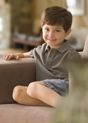 Caucasian boy sitting on sofa