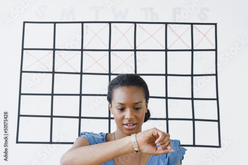 Black woman checking her wristwatch