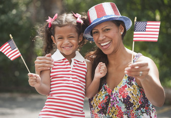 Hispanic mother and daughter celebrating Fourth of July
