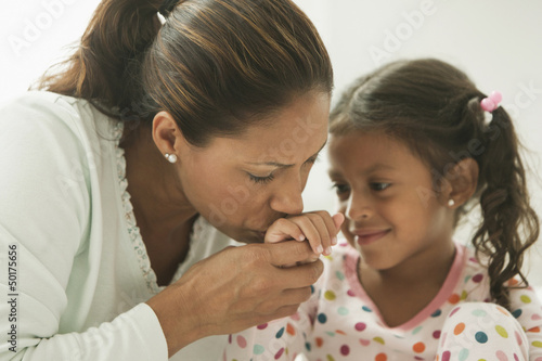 Hispanic mother comforting daughter