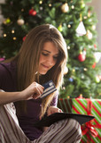 Caucasian woman Christmas shopping online with digital tablet