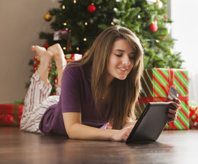 Caucasian woman using digital tablet at Christmas time