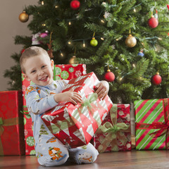 Caucasian boy holding Christmas gift