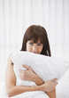 Caucasian woman holding pillow