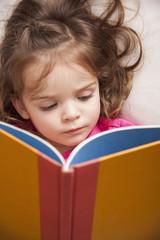 Caucasian girl reading a book