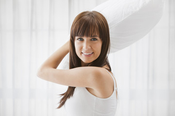 Caucasian woman about to throw pillow