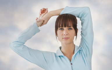 Caucasian woman with arms raised