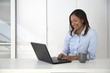 Black businesswoman typing on laptop in office
