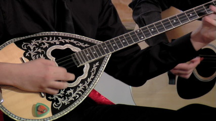 Artist playing bouzouki, close up