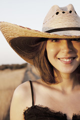 Woman in oversized cowboy hat