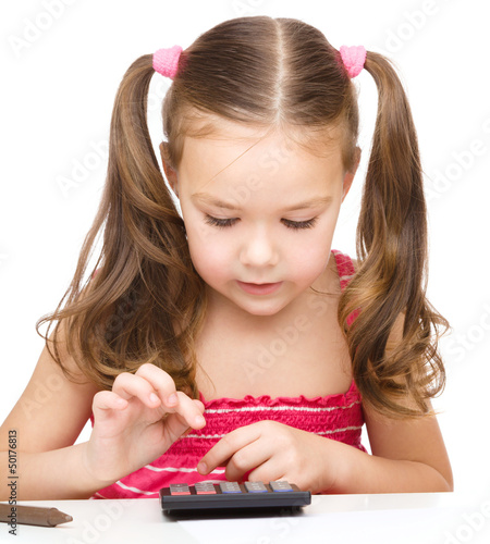 Little girl is using calculator