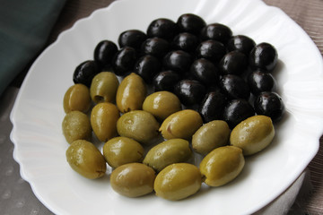 Yin and yang made from black and green olives