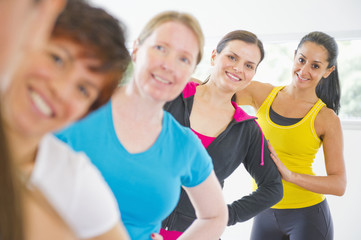 Women standing together in exercise class