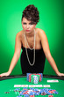 sexy woman shows poker hand