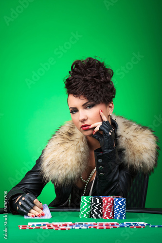 pensive lady plays poker