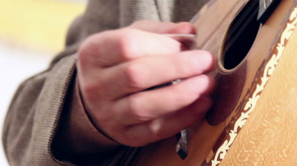 Artist playing mandolin, close up