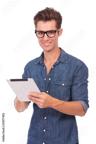 man with tablet smiles at you