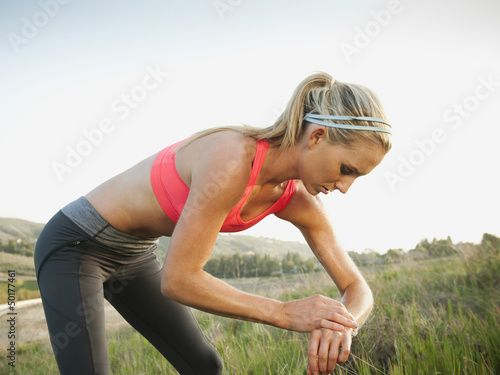 Caucasian woman taking her pulse after exercise