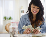 Pacific Islander woman counting money