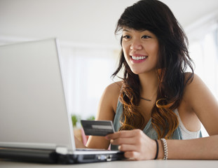 Pacific Islander woman shopping online with credit card