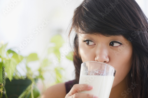 Pacific Islander woman drinking milk