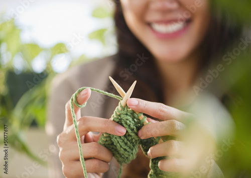 Pacific Islander woman knitting