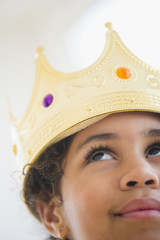 Mixed race girl wearing crown