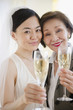 Japanese bride and mother drinking Champagne