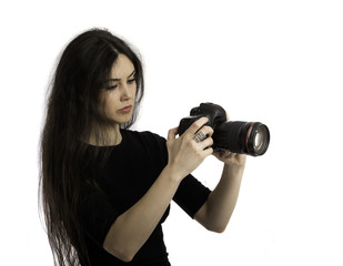The beautiful girl with the camera, isolated on a white backgrou