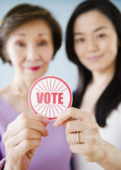Japanese mother and daughter holding vote sticker
