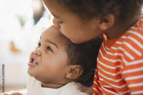 Black boy hugging sister