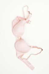 Pink bra laying on ground