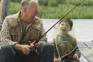 Caucasian boy putting fishing net over his head