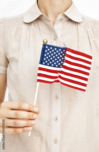Woman holding repaired American flag