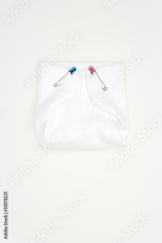 Old-fashioned pins in cloth diaper