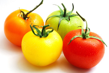 cluster of red yellow orange and green tomatoes