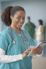 African American nurse using digital tablet