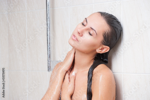 Young beautiful woman washing in the shower