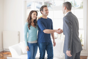 Hispanic couple talking with financial advisor