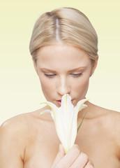 Caucasian woman smelling flower