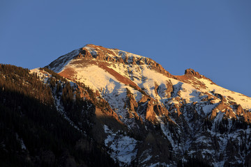 Sunlight on snow covered mountain