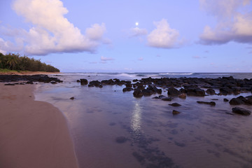 Rocks on tranquil beach